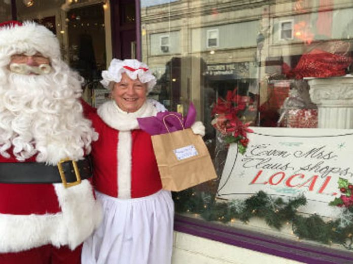 Santa Claus in front of store